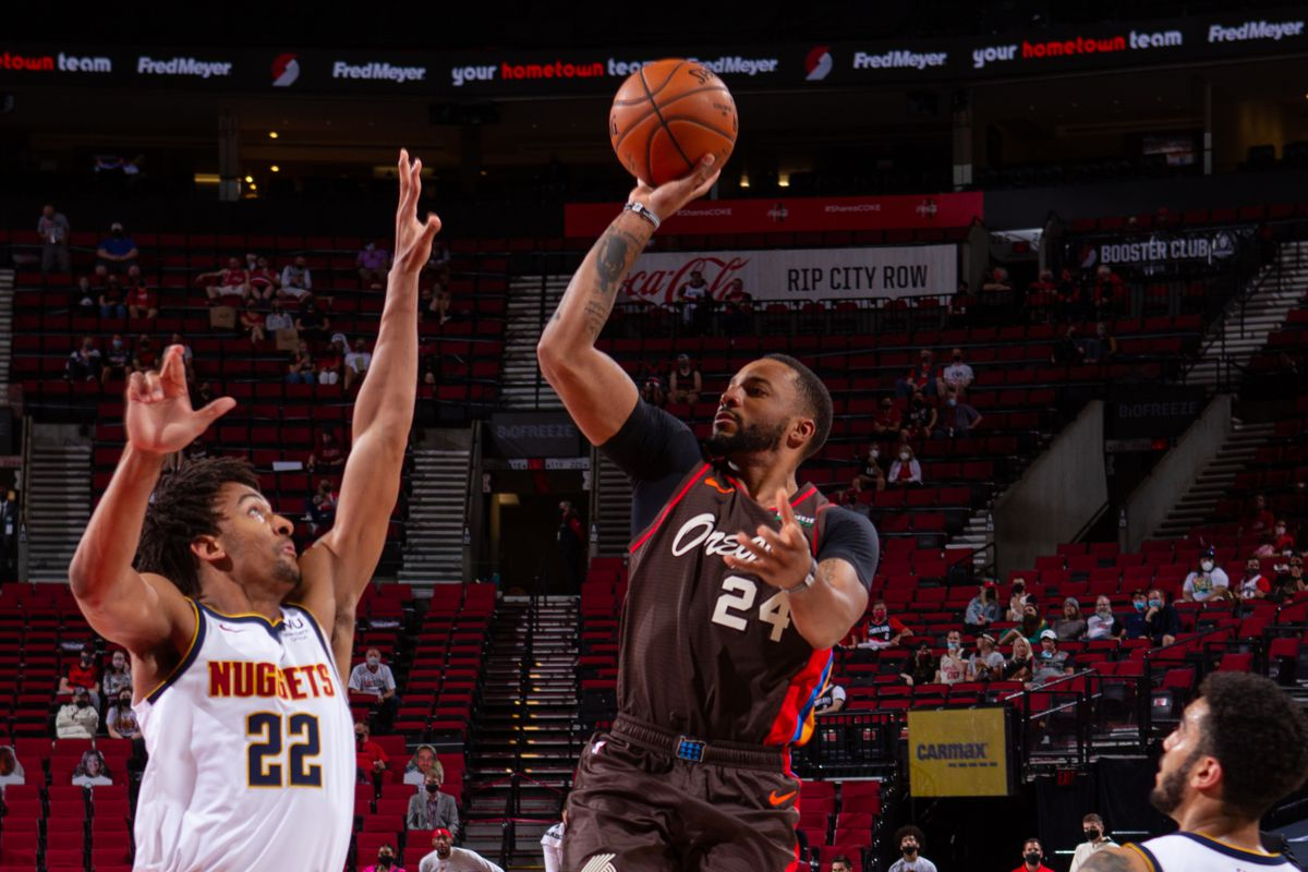Norman Powell #24 of the Portland Trail Blazers shoots the ball during the game against the Denver Nuggets on May 16, 2021 at the Moda Center Arena in Portland, Oregon.