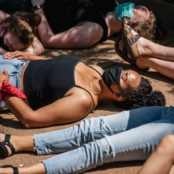 Students gather outside the University of Minnesota Police Department for a die-in on June 07, 2020 in Minneapolis, Minnesota.