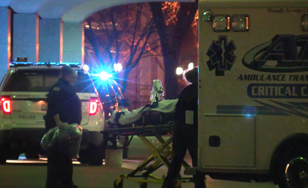 Paramedics take the 33-year-old woman with a gunshot wound to Stroger Hospital. | Network Video Productions