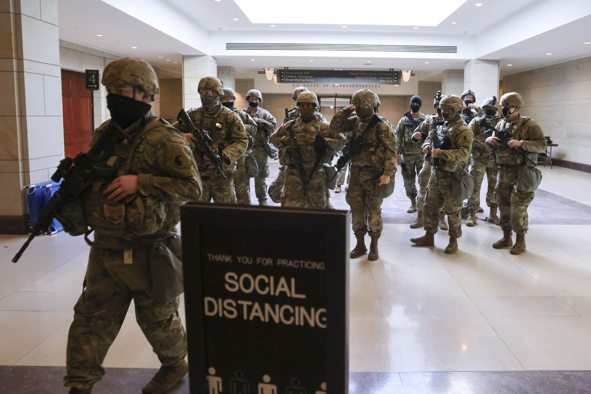 National Guard troops leave the U.S. Capitol Visitor Center during a lockdown due to a threat during the dress rehearsal for the inauguration of President-elect Joe Biden on January 18, 2021 in Washington, DC. The inauguration will take place on January 20.