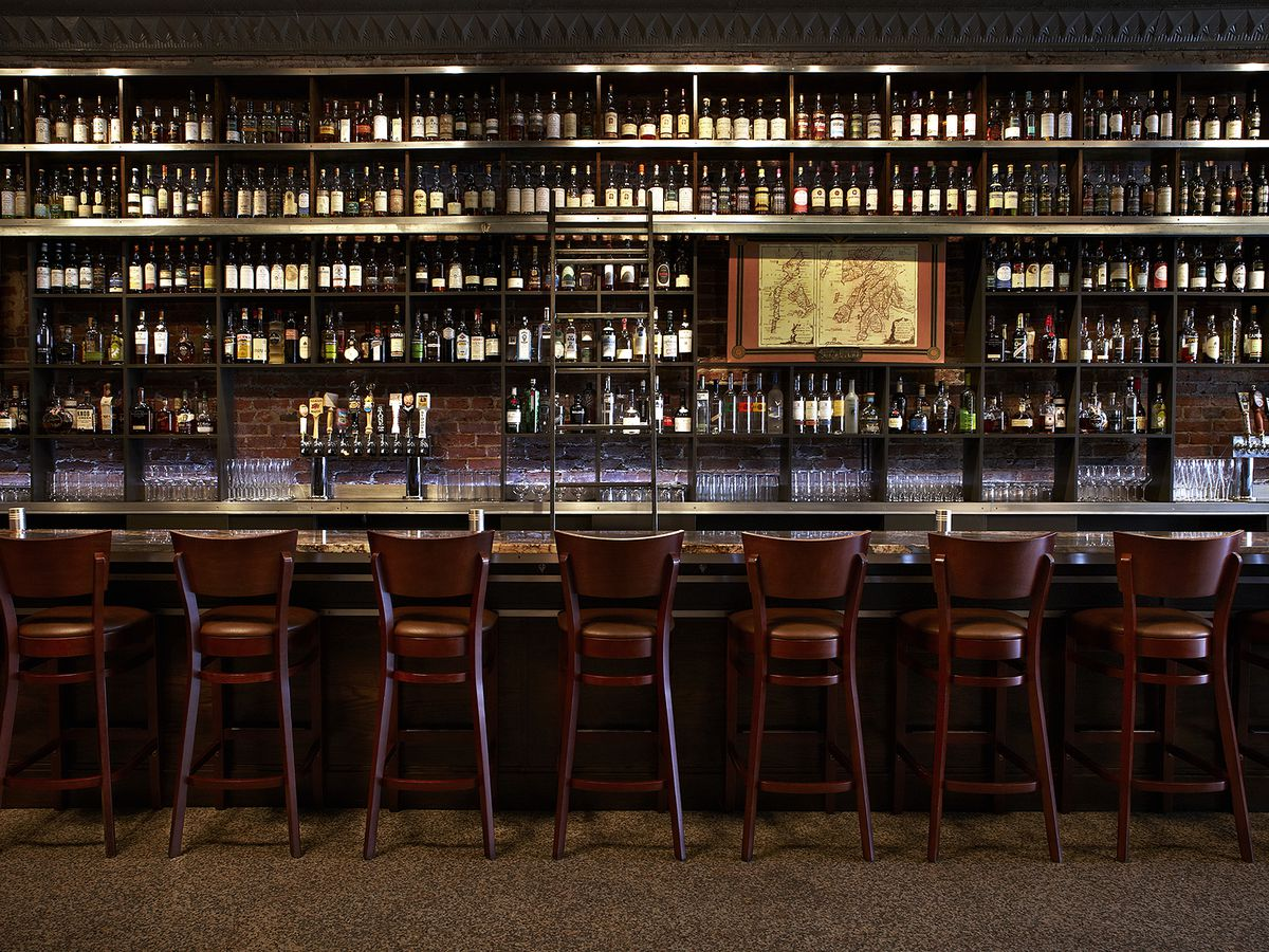 The wall of whiskey at Adams Morgan, with bottles and bottles stacked in rows behind the bar
