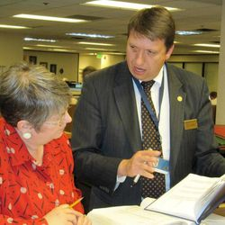 Erin Hunt of Taylorsville, Utah, left, looks through Irish land records with family history library staffer Mark Gardner at the Mormon church-owned library in Salt Lake City in this May 4, 2010 photo.