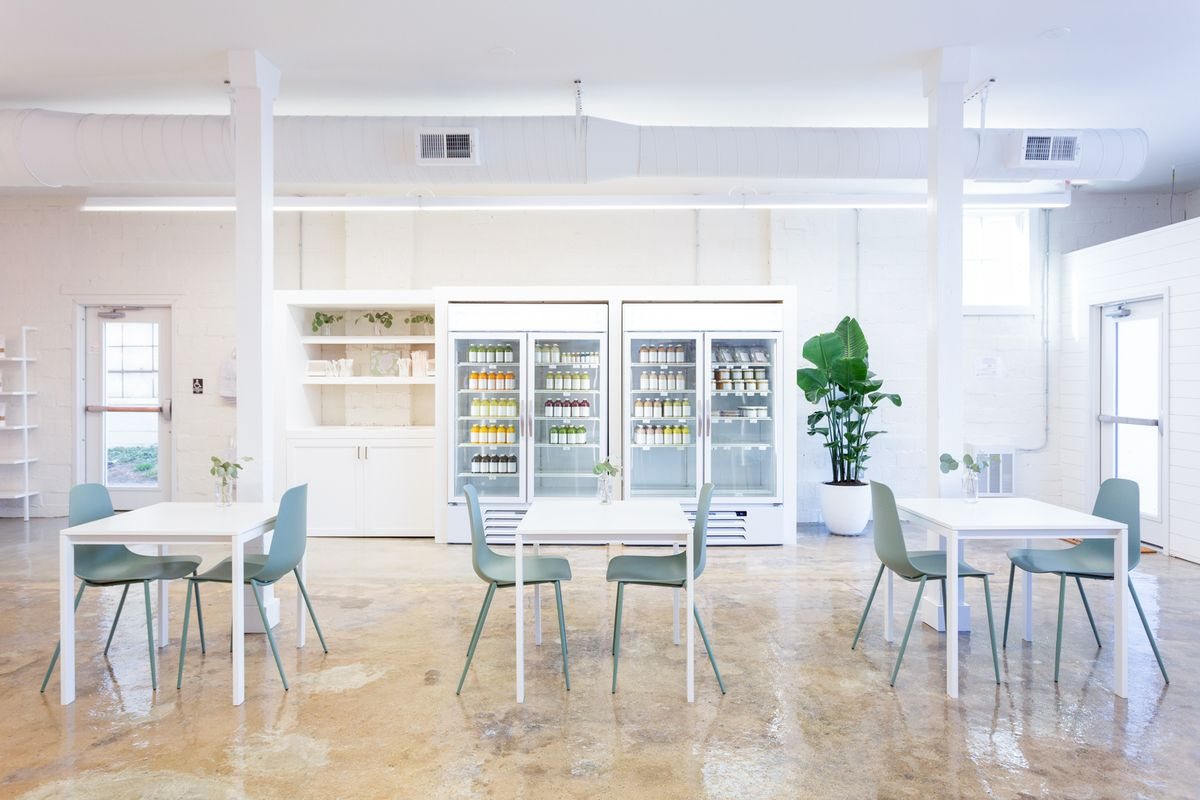 The stark white interior at Greenheart Juice Shop's new location in Vienna
