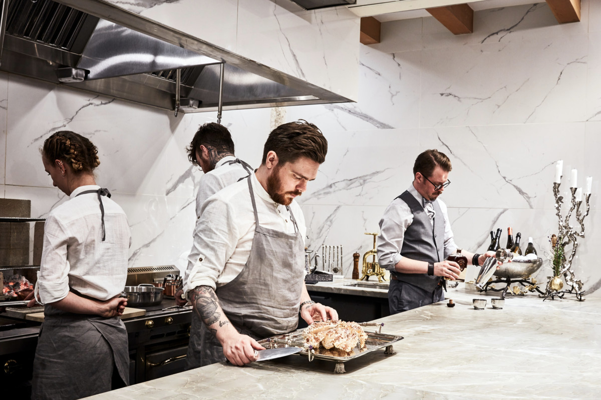 Chef Phillip Frankland Lee stands over a dish at the Silver Bough fine dining restaurant.