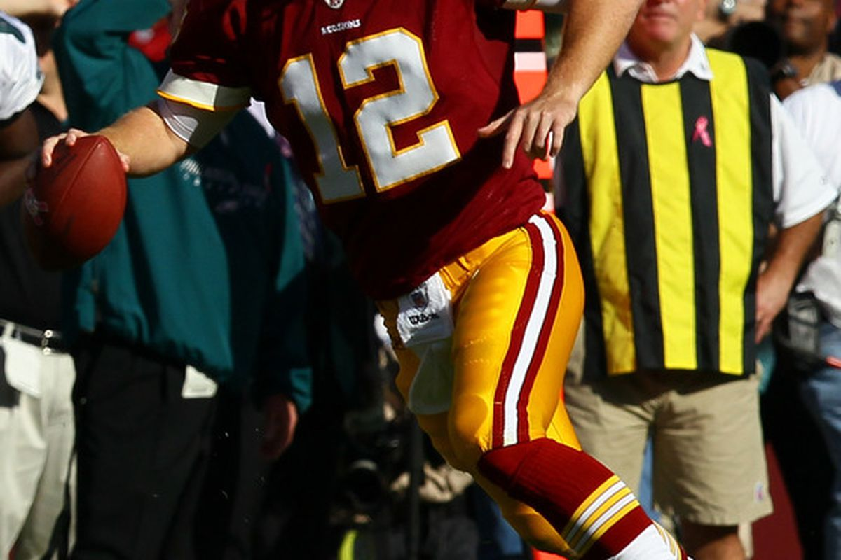 LANDOVER, MD - OCTOBER 16:  Quarterback John Beck #12 of the Washington Redskins scrambles against the Philadelphia Eagles at FedExField on October 16, 2011 in Landover, Maryland. The Eagles won the game 20-13.  (Photo by Win McNamee/Getty Images)