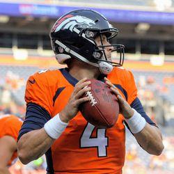 Broncos QB Case Keenum looks downfield.