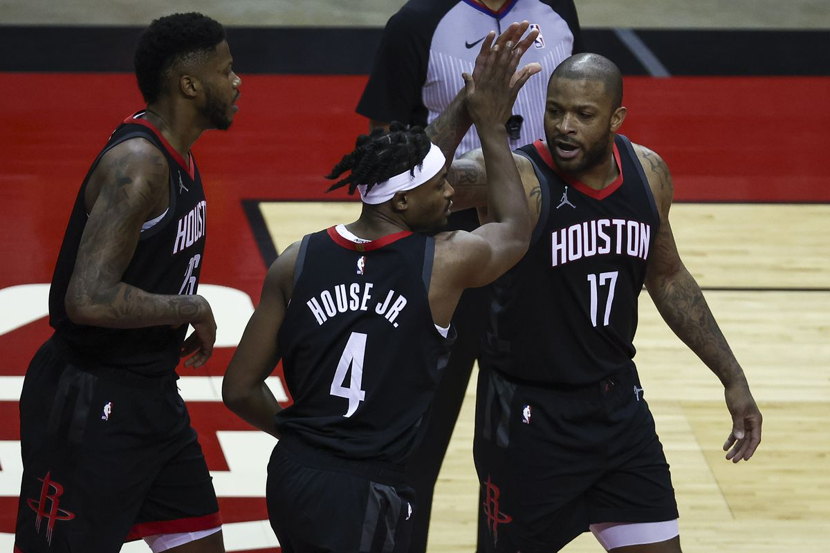 Houston Rockets forward Danuel House Jr. (4) and forward P.J. Tucker (17) react after a play during the first quarter against the Memphis Grizzlies at Toyota Center.