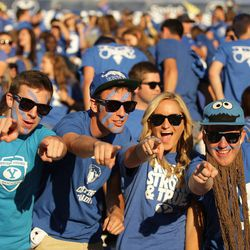 Brigham Young Cougars fans yell prior to the game in Provo Friday, Oct. 3, 2014.