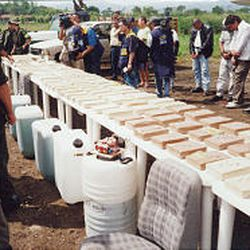 Law enforcement officials display drugs seized in a bust in Colombia in 2002. Utah attorney Rob Lunnen helped Colombian officials at the time.