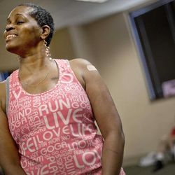 In a Wednesday, April 25, 2012 photo, cancer survivor Hastine Reese, 50, of Stockbridge Ga., talks after an exercise class, in Atlanta. A cancer diagnosis often inspires people to exercise and eat healthier. Now the experts say there's evidence that that may help the disease from returning. The American Cancer Society on Thursday issued new guidelines urging doctors to talk to their cancer patients about slimming down if they're fat, eating right and doing some exercise.