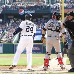 DETROIT, MI - APRIL 07: Miguel Cabrera #24 of the Detroit Tigers hits a two run home run in the first inning as Jarrod Saltalamacchia #39 of the Boston Red Sox and home plate umpire Bill Miller look on during the game at Comerica Park on April 7, 2012 in Detroit, Michigan.  (Photo by Leon Halip/Getty Images)