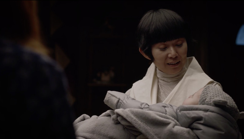 Lady Trieu with a baby in Watchmen.