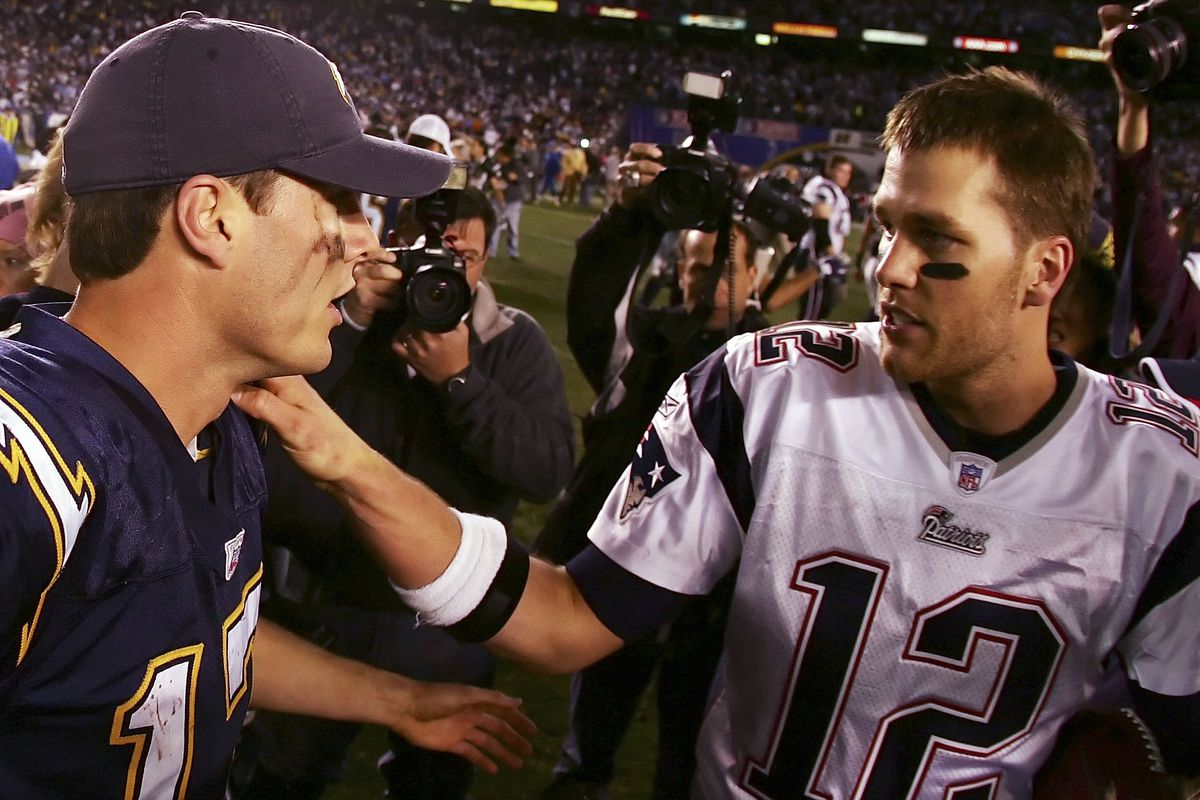 Quarterback Philip Rivers #17 of the San Diego Chargers and quarterback Tom Brady #12 of the New England Patriots meet after the AFC Divisional Playoff Game held on January 14, 2007 at Qualcomm Stadium in San Diego, California. The Patriots defeated the Chargers 24-21.