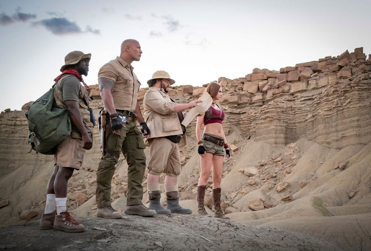 Kevin Hart, Dwayne Johnson, Jack Black, and Karen Gillan face the desert.