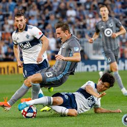 July 27, 2019 - Saint Paul, Minnesota, United States - Vancouver Whitecaps midfielder Inbeom Hwang (4) receives a yellow card after a harsh tackle on Minnesota United midfielder Ethan Finlay (13) during the match at Allianz Field.