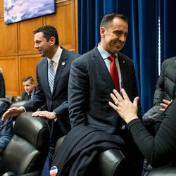 Rep. Jason Chaffetz, R-Utah, second from left, and Utah House Speaker Greg Hughes, R-Draper, talk to people during a Utah delegation reception in the House Oversight and Government Reform Committee Room in the Rayburn Building in Washington, D.C., on Thursday, Jan. 19, 2017.