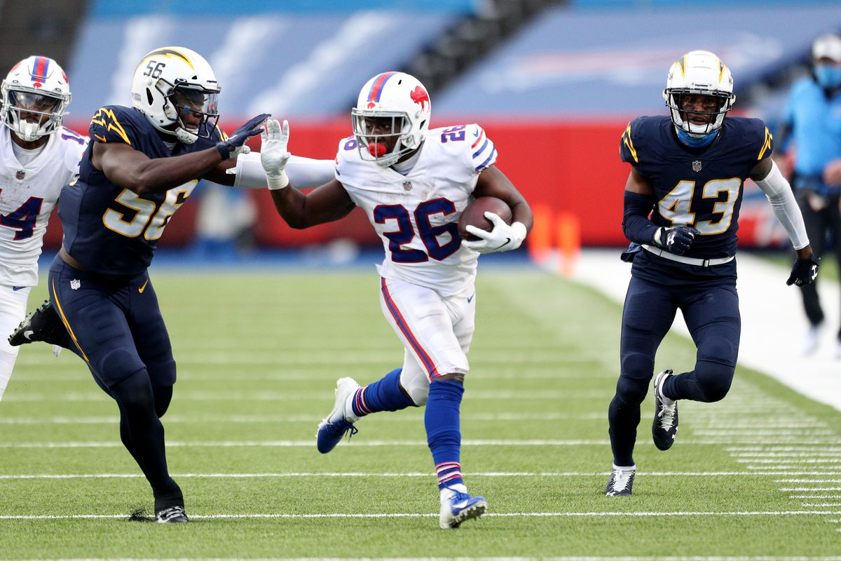 Kenneth Murray #56 of the Los Angeles Chargers looks to tackle Devin Singletary #26 of the Buffalo Bills during the fourth quarter at Bills Stadium on November 29, 2020 in Orchard Park, New York.