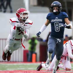 American Fork safety Peyton Wilson (7) intercepts a pass for Corner Canyon receiver Noah Kjar (8) in the first half of the 6A High School football game at Rice-Eccles Stadium in Salt Lake City on Friday, November 22, 2019 .