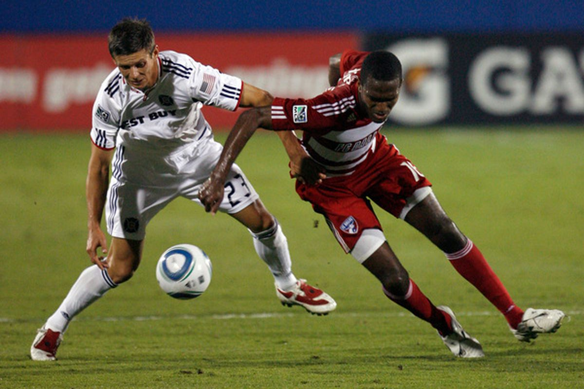 FRISCO TX - OCTOBER 02:  Defender Krzysztof Krol #23 of the Chicago Fire dribbles the ball against midfielder Atiba Harris #16 of FC Dallas at Pizza Hut Park on October 2 2010 in Frisco Texas.  (Photo by Tom Pennington/Getty Images)