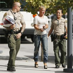 Salt Lake County sheriff's deputies walk with a woman who was arrested as part of Operation Diversion in Salt Lake City on Thursday, Sept. 29, 2016. The operation is a coordinated effort between Salt Lake County, Salt Lake City and drug treatment providers to strategically attack the drug market that has permeated the homeless population spilling out of downtown shelters. Those who were arrested were transported to the Salt Lake County Jail or to a temporary receiving center where medical experts will screen them for possible referral to appropriate behavioral health services.