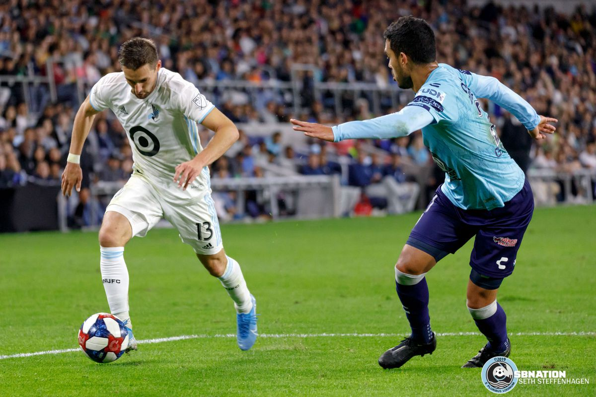September 7, 2019 - Saint Paul, Minnesota, United States - Minnesota United midfielder Ethan Finlay (13) dribbles into the box as Pachuca defender Gustavo Cabral (21) during the Minnesota United vs Pachuca international friendly match at Allianz Field.