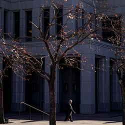 A lone man walks outside The Church of Jesus Christ of Latter-day Saints' Conference Center in Salt Lake City before the start of the 190th Annual General Conference on Saturday, April 4, 2020. Due to the spread of COVID-19, the conference is being broadcast without church members in attendance.