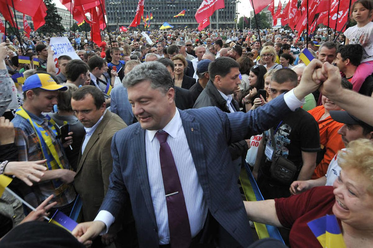 May 18, 2014 - Ukrainian presidential candidate Petro Poroshenko, center, is welcomed by his supporters during a rally in Zaporizhzhia, Ukraine.