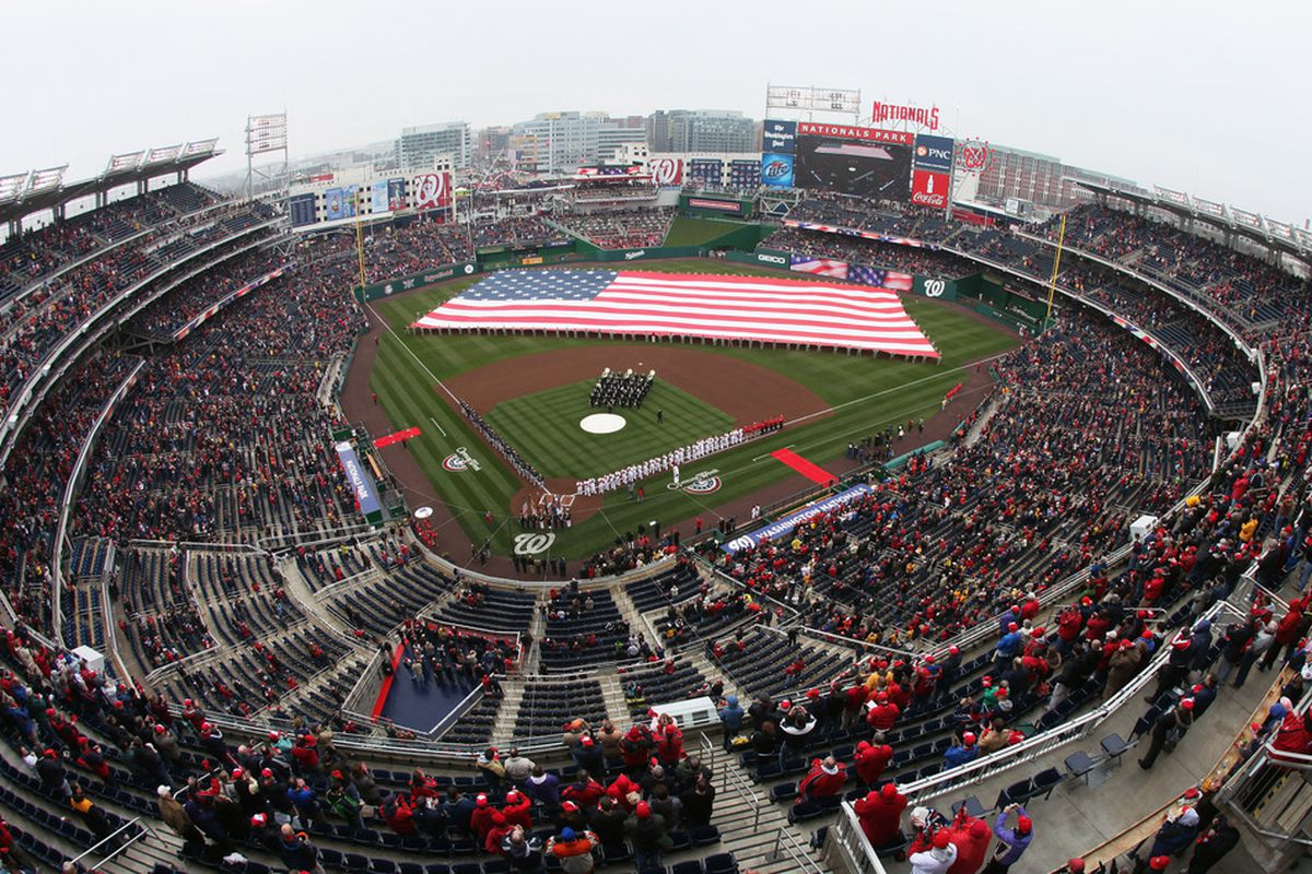 WASHINGTON, DC - MARCH 31:  Members of the Atlanta Braves and Washington Nationals stand on the field during the national anthem before the start of opening day at Nationals Park on March 31, 2011 in Washington, DC.  (Photo by Rob Carr/Getty Images)