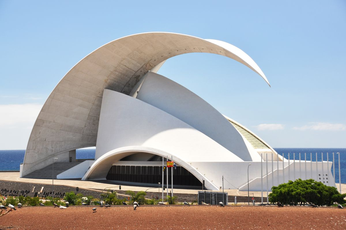 The exterior of the Auditorium on Tenerife. The facade is white and shaped like a wave.