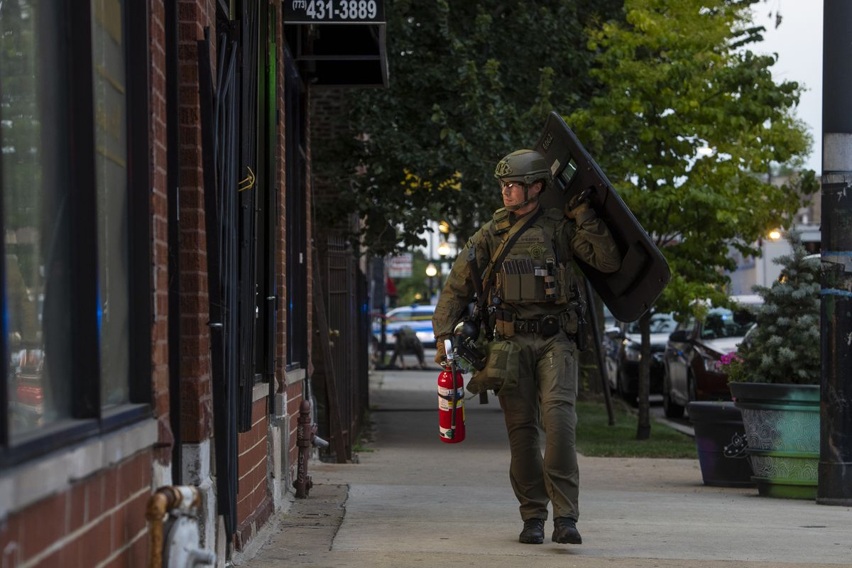 Chicago police and SWAT respond to a barricade situation after a person allegedly shot and critically wounding a 69-year-old man, and then barricading himself in a nearby home, in the 5900 block of South Richmond St. in the Chicago Lawn.