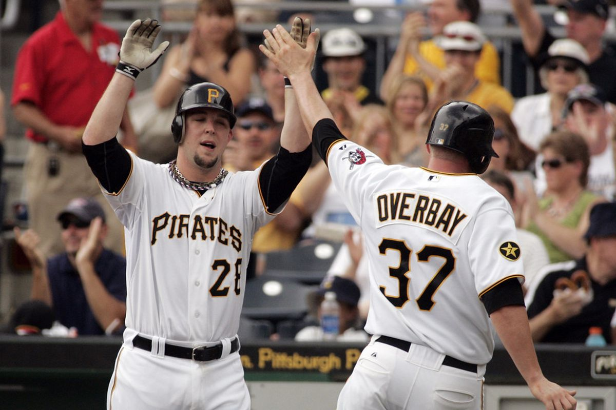 PITTSBURGH, PA - JULY 04:  Lyle Overbay #37 of the Pittsburgh Pirates celebrates a run with Paul Maholm #28 during the game against the Houston Astros on July 4, 2011 at PNC Park in Pittsburgh, Pennsylvania.  (Photo by Justin K. Aller/Getty Images)