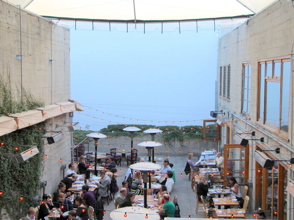 The outdoor dining space at Foreign Cinema, sandwiched between two buildings