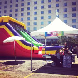 A jumbo slide and face painting station for the kiddies.