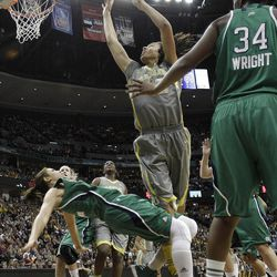 Baylor center Brittney Griner (42) shoots between Notre Dame forward Natalie Achonwa (11) and Notre Dame forward Markisha Wright (34) during the first half in the NCAA women's Final Four college basketball championship game, in Denver, Tuesday, April 3, 2012.  (AP Photo/Eric Gay)