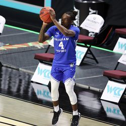 Brigham Young Cougars guard Brandon Averette (4) puts up a 3-point shot as BYU and Gonzaga prepare to play in WCC men's basketball tournament finals at the Orleans Arena in Las Vegas on Tuesday, March 9, 2021.