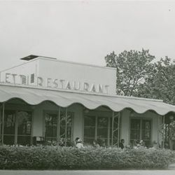 """The exterior of the Toffenetti building at the World's Fair via the <a href=""""http://digitalgallery.nypl.org/nypldigital/dgkeysearchdetail.cfm?strucID=1801310&imageID=1681347"""">New York Public Library digital archives</a>."""