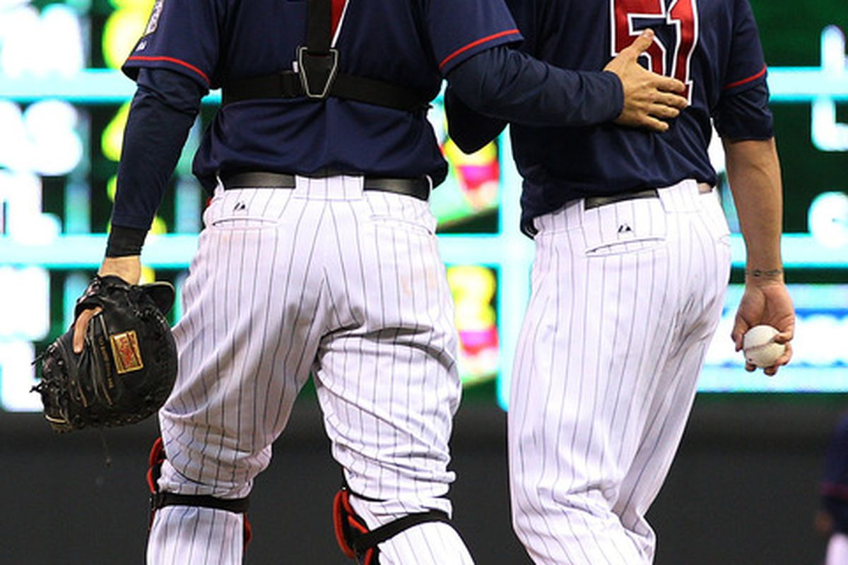 May 25, 2012; Minneapolis, MN, USA: Minnesota Twins catcher Joe Mauer (7) talks with Minnesota Twins relief pitcher Anthony Swarzak (51) during the second inning against the Detroit Tigers at Target Field. Mandatory Credit: Jesse Johnson-US PRESSWIRE