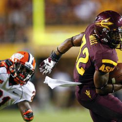 Arizona State wide receiver Jamal Miles (32) slips past Illinois defensive back Jack Ramsey (21) during the first half of an NCAA college football game, Saturday, Sept. 8, 2012,in Tempe, Ariz.
