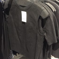 Sleeveless black leather top, $129 (was $525)