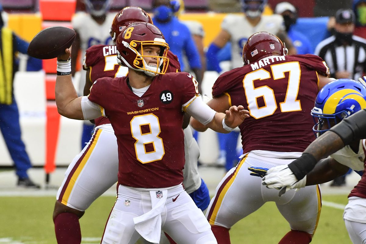 Washington Football Team quarterback Kyle Allen attempts a pass against the Los Angeles Rams during the second quarter at FedExField.