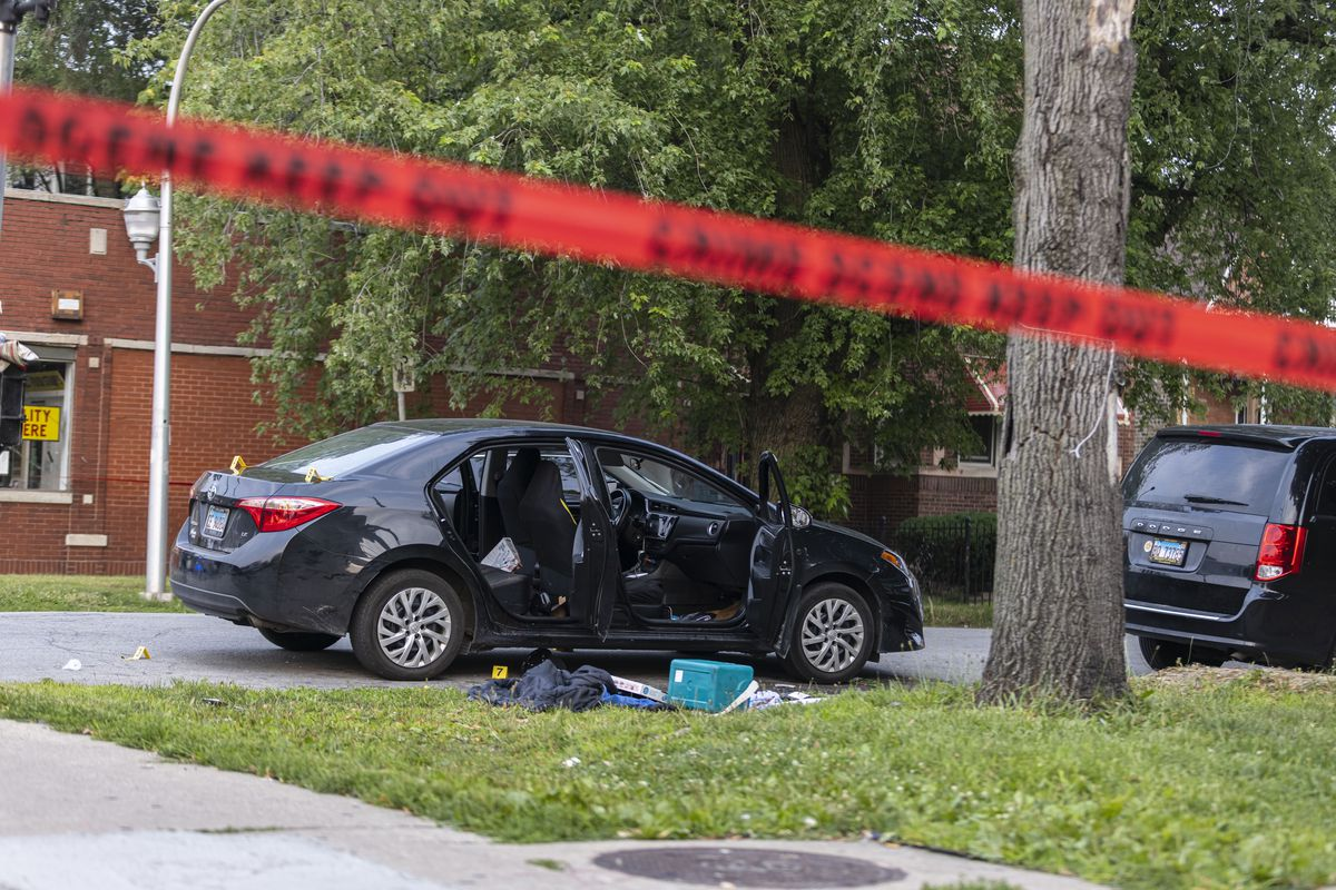 Vehicle and belongings at the scene at the corner of E 71st St and S Indiana Ave in Park Manor where a 17-year-old was shot and pronounced dead at the hospital, Tuesday, July 20, 2021.   Anthony Vazquez/Sun-Times