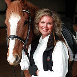 Ann Romney with her horse, Momento, in 1999 after diagnosis of MS. Riding helps with mobility.