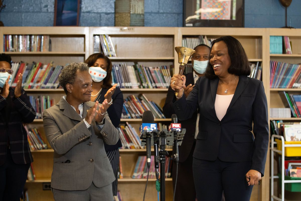 Chicago Mayor Lori Lightfoot claps as Chicago Public Schools CEO Dr. Janice Jackson rings a bell at Dr. Martin Luther King, Junior Academy of Social Justice in Englewood on the first day back to school Tuesday morning, Sept. 8, 2020.