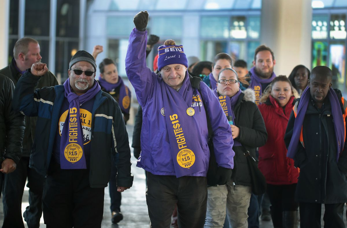 Workers and union representatives at O'Hare International Airport in 2016.