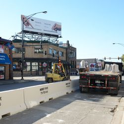 11:44 a.m. Traffic on Addison Street being stopped, as the last barricades are placed into position -