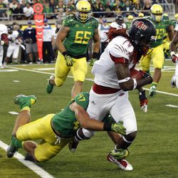 Arkansas State wide receiver Josh Jarboe, right, tries to elude Oregon defender Kiko Alonso during the first half of their NCAA college football game in Eugene, Ore., Saturday, Sept. 1, 2012.