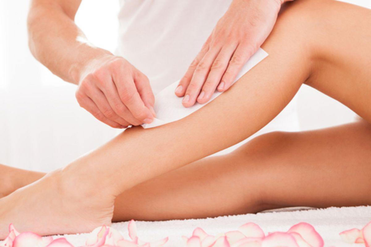 """Image via <a href=""""http://www.shutterstock.com/pic-121316683/stock-photo-beautician-waxing-a-woman-s-leg-applying-a-strip-of-material-over-the-hot-wax-to-remove-the-hairs.html"""">shutterstock</a>"""
