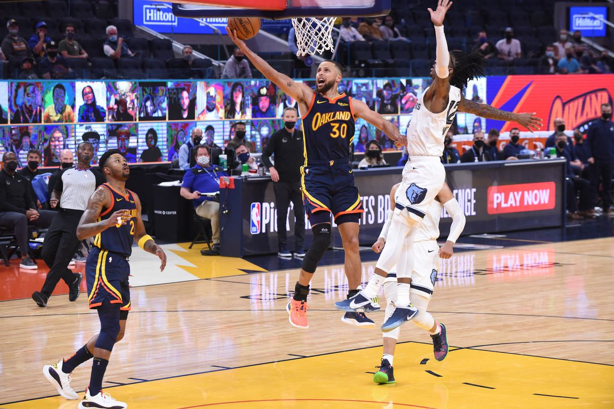 Ja Morant #12 of the Memphis Grizzlies attempts to block Stephen Curry #30 of the Golden State Warriors during the 2021 Play-In Tournament game on May 21, 2021 at Chase Center in San Francisco, California.