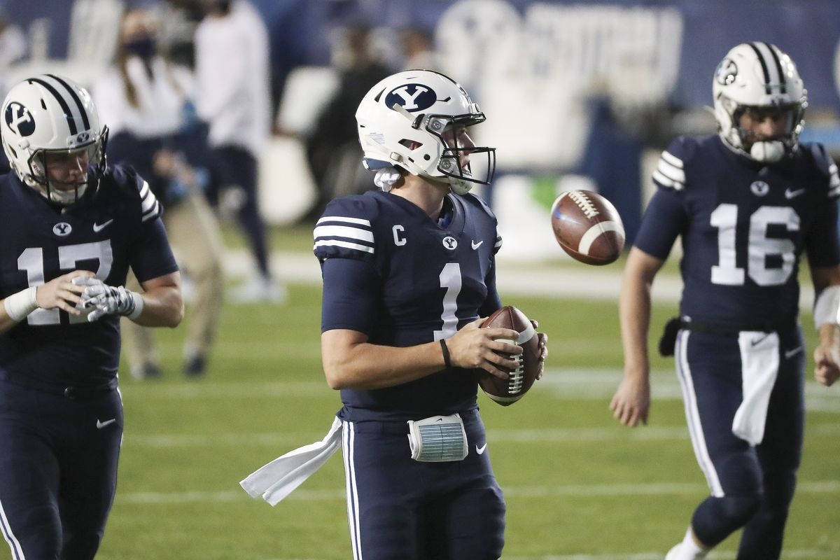 BYU quarterbacks Jacob Conover, Zach Wilson and Baylor Romney warm up prior to a game. Pro Football Focus predicts Romney will replace Wilson in 2021.