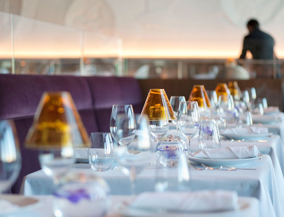 White cloth tables with purple seating